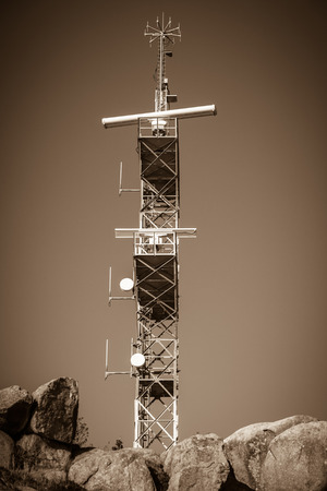 communication tower: A navigation communication tower against the sky. Sepia shot Stock Photo