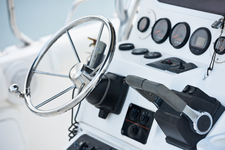 implement: Sailing yacht control wheel and navigation implement. Horizontal shot without people