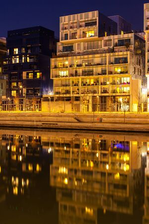 confluence: FRANCE, LYON - FEBRUARY 19: The Confluence District in Lyon, France on February 19, 2013. New district with an modern architecture in the place of the old port. Night shot