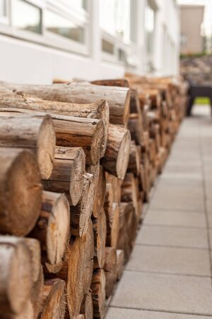 woodpile: Logs woodpile near modern building house wall. Selective focus