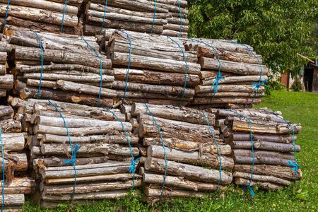 bounded: Big pile of wood logs on a rural background Stock Photo