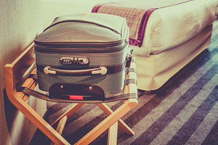 linen bag: Hotel room with a suitcase on the luggage place and the bed. Filtered shot