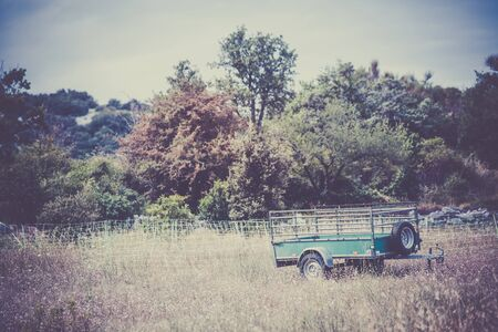 filtered: Old cargo trailer in a rural place. Vintage filtered shot Stock Photo