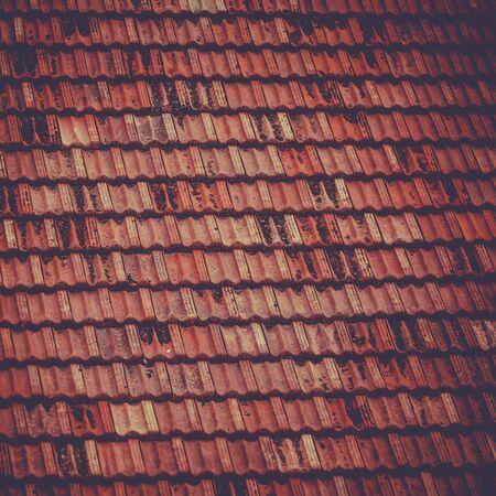 vignetted: Roof tile background. Square filtered vignetted image