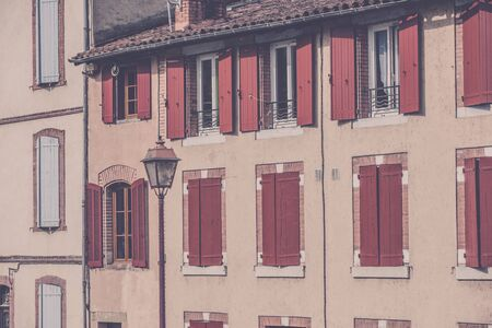 filtered: House facade with windows shutters in France. Filtered shot