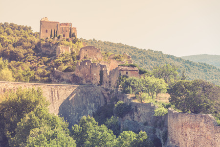 apt: View of Saint Saturnin les Apt, Provence, France. Castle ruins on a hill above the village