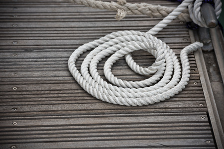 cleat: A mooring rope with a knotted end tied around a cleat on a wooden pier