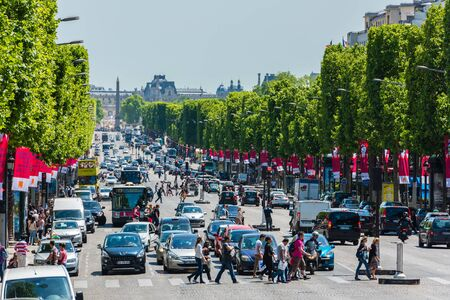 champs elysees: FRANCE, PARIS - JUNE 06: View of the Champs Elysees Avenue in Paris in the afternoon on June 06, 2015. Hard car traffic and a lot of people Editorial