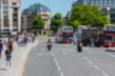 street shot: Blur defocused shot of Paris street with people and cars