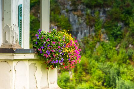 flowers horizontal: House facade with balcony and flowers. Horizontal shot with a selective focus