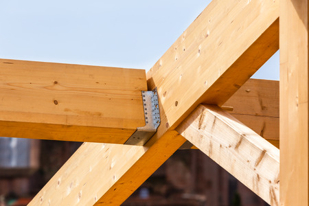 roof framing: Construction of new wooden house. Beams frame close up