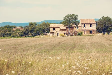 filtered: Stone house in a harvested field, Provence, France. Filtered image
