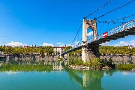 france: Old Passerelle du College bridge over Rhone river in Lyon, France. Summer day