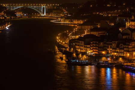 ribeira: Overview of Old Town of Porto, Portugal at night. Ribeira and Douro river Stock Photo