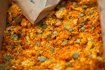 heap up: Dry marigold heap on a french farmers market. Close Up with small GRIP and selective focus