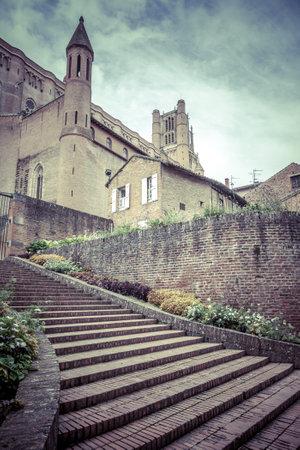 palais: Entrance to Palais de la Berbie Gardens at Albi, Tarn, France. Vertical filtered shot