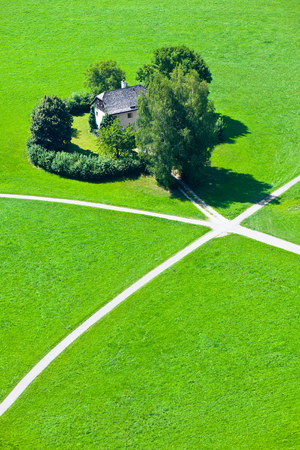walking paths: Intersection of five walking paths and a house in green field