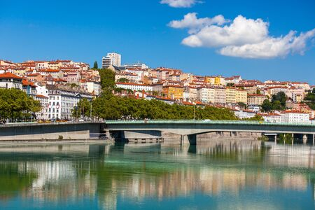 france: Cityscape of Lyon, France with reflections in the water. Bright sunny day