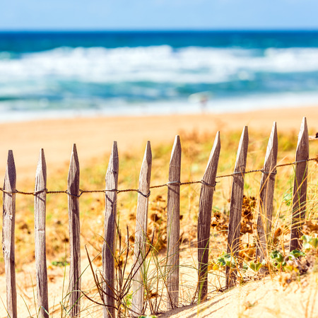gironde department: Wooden fence on an Atlantic beach in France, The Gironde Department. Square filtered Shot with a selective focus