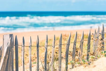 gironde department: Wooden fence on an Atlantic beach in France, The Gironde Department. Filtered shot with a selective focus Stock Photo