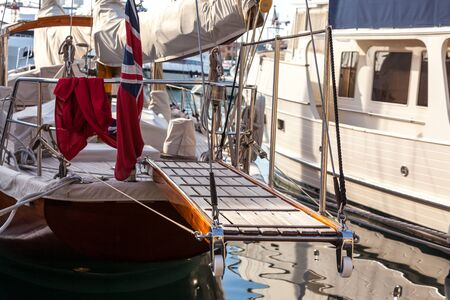 gangway: wooden gangway on marine yacht staying in port. luxury tourism