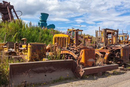 bulldozers: Old rusty and weathered bulldozers. Outdoors horizontal shot