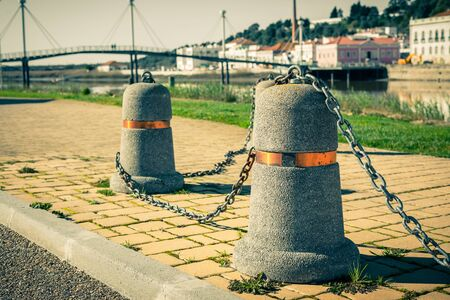 chain links: Stub posts linked in a chain on a quay in a small Portugal town