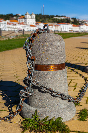 chain linked: Stub posts linked in a chain on a quay in a small Portugal town