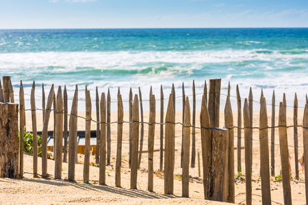 gironde: Wooden fence on an Atlantic beach in France, The Gironde Department. Shot with a selective focus