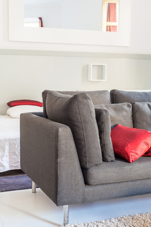 vacate: Modern apartments cozy furniture: a sofa with pillows Stock Photo