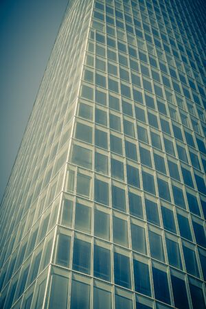 filtered: Office glass skyscraper building. Vertical filtered shot Stock Photo