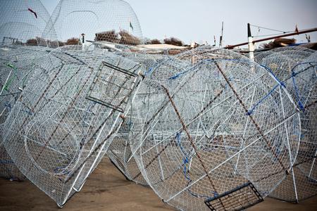 trawl: Metal fishing nets in a port. Horizontal shot Stock Photo