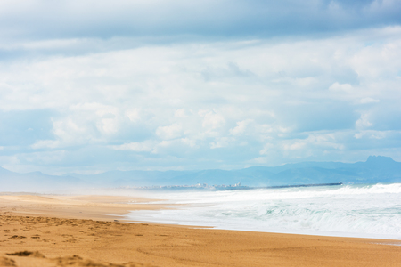 gironde department: Long Sand Atlantic Beach with ocean waves. The Gironde Department, France. Shot with a selective focus