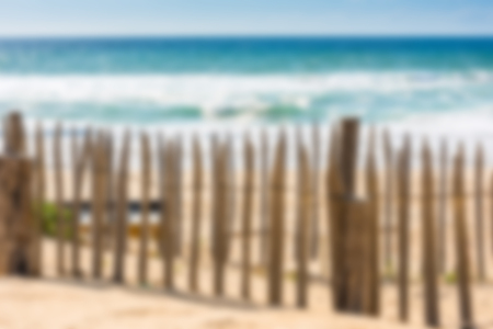 gironde department: Wooden fence on an Atlantic beach in France, The Gironde Department. Defocused Shot Stock Photo