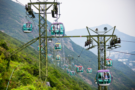 cope: HONG KONG, HONG KONG - OCTOBER 01: cable cars over tropical trees in Hong Kong on October 01, 2012 Editorial