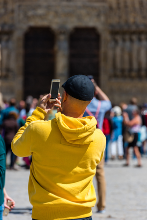 01: FRANCE, PARIS - JUNE 01: Man taking pictures of the Notre Dame Cathedral in Paris on June 01, 2015