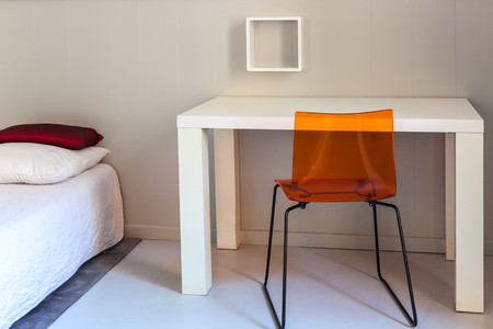vacate: Bed, table and chair, scene in apartments room. Horizontal shot Stock Photo