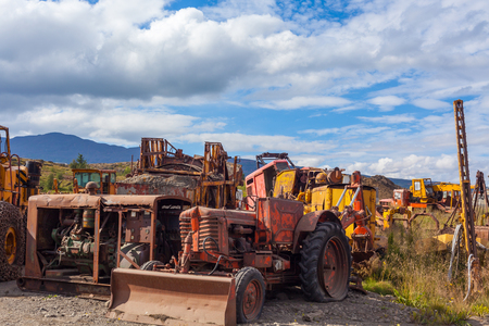 earth moving equipment: Old rusty and weathered bulldozers. Outdoors horizontal shot