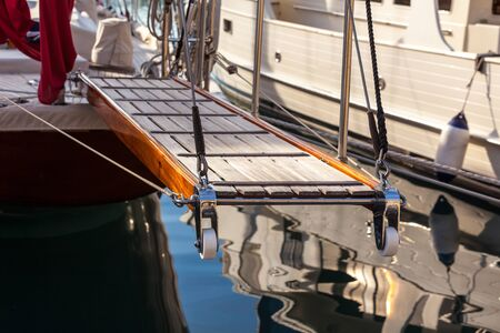 gangway: wooden gangway on marine yacht staying in port. luxury tourism
