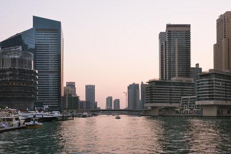 december 31: UAE, DUBAI - DECEMBER 31: Skyscrapers silhuette at sunset in Dubai marina on December 31, 2014