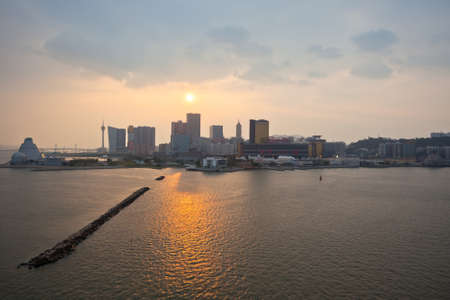 macao: MACAO, MACAO - SEPTEMBER 28: Skyline of Macao cityscape at outer harbour before sunset on September 28, 2012 Editorial