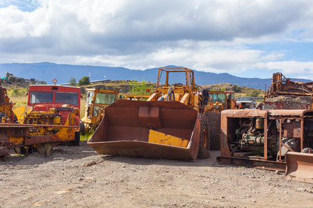 lumbering: Old rusty and weathered bulldozers. Outdoors horizontal shot