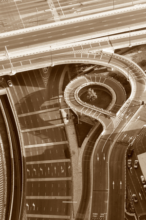 Top view of highway interchange in Dubai, UAE. Sepia toned