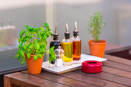 cafeteria tray: Balsamic vinegar and oil bottles and condiments on the table in an outdoor cafe