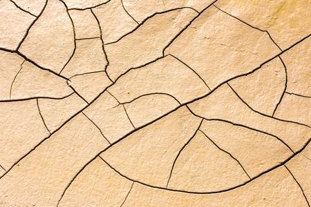 Les détails d'un sol de terre craquelée sèche. Contexte Banque d'images - 53644836