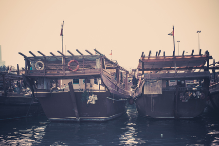 persian gulf: Old fishing boats in the Persian Gulf. Filtered shot Stock Photo