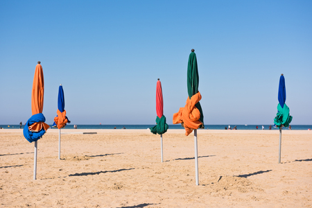 basse normandy: The famous colorful parasols on Deauville beach, Normandy, Northern France