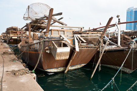 persian gulf: Old fishing boats with rusty metal nets in the Persian Gulf