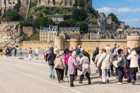 michel: FRANCE, MONT SAINT MICHEL - SEPTEMBER 26: Old people visiting Mont Saint Michel monastery, Brittany, France on September 26, 2015 Editorial