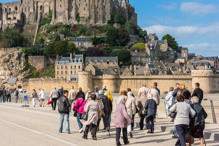 mont saint michel: FRANCE, MONT SAINT MICHEL - SEPTEMBER 26: Old people visiting Mont Saint Michel monastery, Brittany, France on September 26, 2015 Editorial